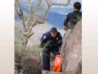 Police_with_man_on_Camelback_Mountain_20111105151707_JPG