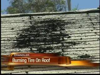 Apartment fire started by a burning tire on the roof
