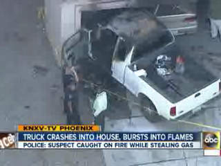 Truck crashes into house, bursts into flames