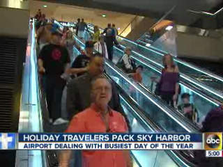 Holiday travelers jamming into Sky Harbor