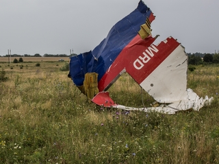 Fighting forces MH17 investigators to turn back