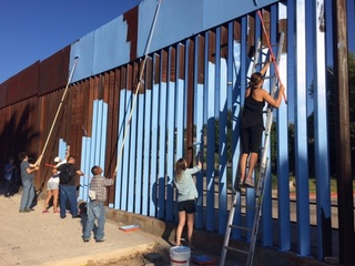 Artist paints border fence to make it invisible