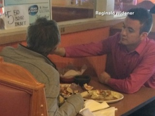 Waiter hailed a hero, helps feed handless man