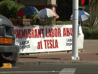 'Immigrant labor abuse' banner outside of Tesla