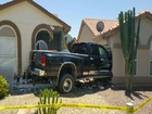 Driver crashes into two houses in Chandler