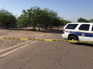 Murder suspect shot by police in south Phoenix