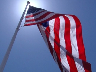 Veteran involved in scuffle over tattered flag