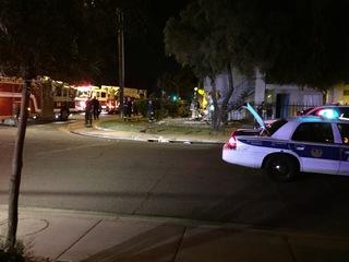 Deadly crash into apartment closes intersection