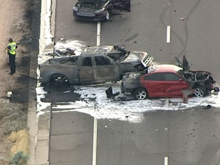 2 cars erupt in flames after 4 car collision