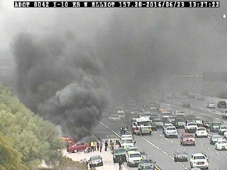 DPS: Two critical after rollover, fire on I-10