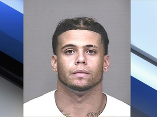 UA football player arrested for assault