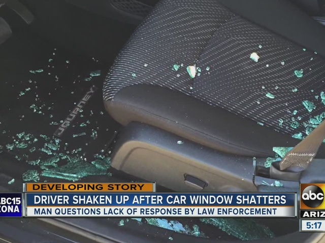 Man driving on I-10 has driver's side window shattered