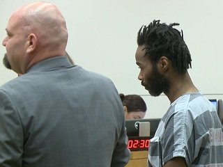 Man who ran over PHX officers pleads not guilty