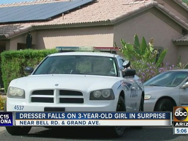 Surprise girl hospitalized after trapped under dresser
