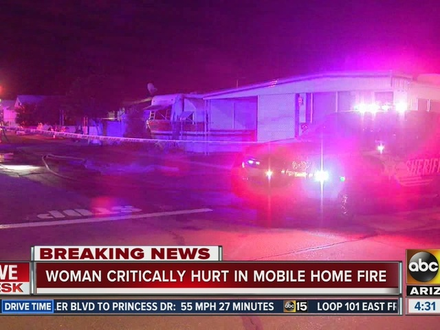 Woman in critical condition after being pulled from a mobile home fire