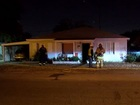 Car collides into home, driver tased by police