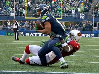 Lockett has surgery after ugly injury vs. Cards