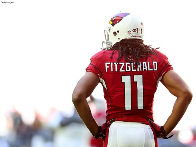 ... JERSEYS - Larry Fitzgerald Wide receiver Larry Fitzgerald 11 of the  Arizona Cardinals warms up before the NFL game against ... 10195fd43