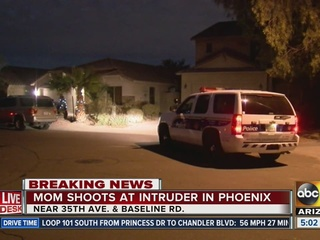 PHX woman shoots at man coming through window