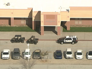 Lockdown lifted after gun seen at Peoria school
