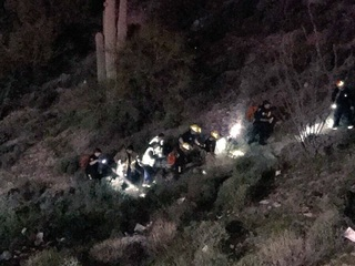 Woman drives car off cliff near Apache Junction