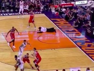 NBA mascot dives onto floor, disrupts game