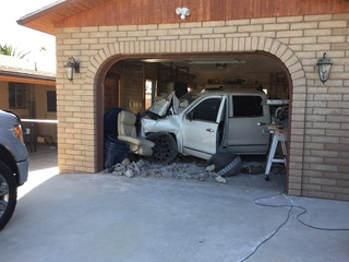 Man accused in crime spree crashes into garage