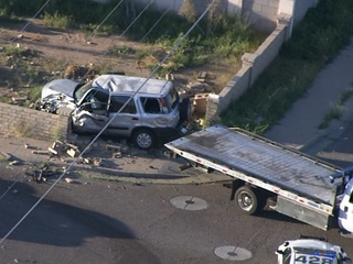 PHX FD: 2 hurt in crash that sent car into wall