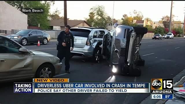 NEW- Uber grounding self-driving cars in Arizona