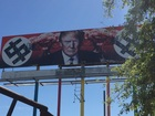 Anti-Trump billboard vandalized with paintballs