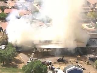 Phoenix fire crews battle hay fire in Laveen