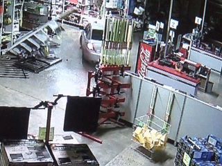 Video shows car smash into, out of Peoria store