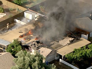 Crews fight spread of fire in Mesa neighborhood