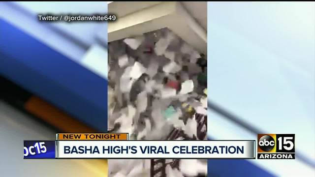 Seniors toss mounds of paper down stairwell as part of tradition