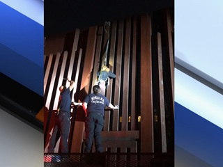 Agents find woman dangling from border fence