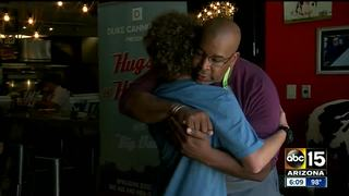 Man's mission is to hug, high five thousands