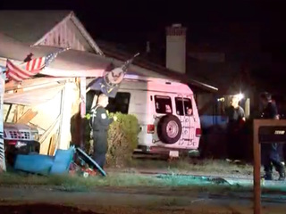 Officials: Teen drives van into Phoenix home