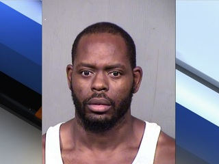 PD: Man accused of using a hanger to choke son