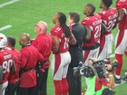 Cardinals stand, lock arms for national anthem