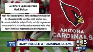 Dad: Baby hit by falling pole at Cards game