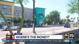 Apartment residents waiting for money promised