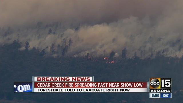 Cedar Creek Fire prompts evacuations shuts down US 60 near Show