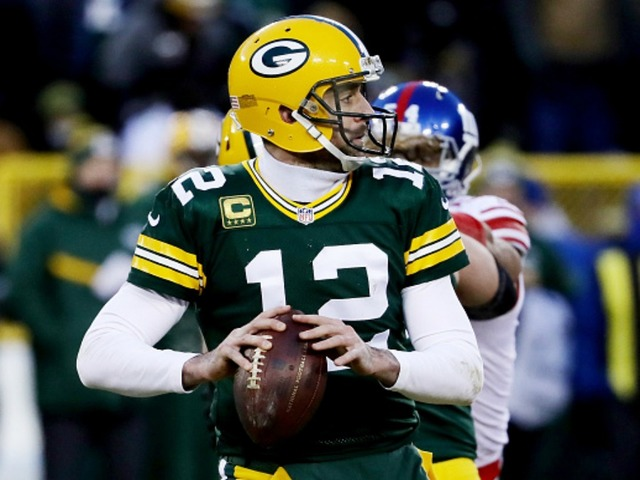 He Did It Again Watch Aaron Rodgers Throw Another Hail Mary TD In The Playoffs