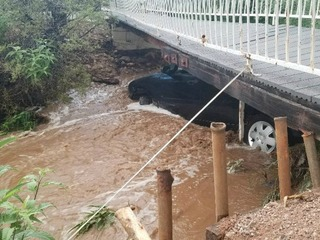 2 saved after cars lodged under bridge in water