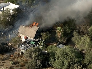 Firefighters battle house fire in Cave Creek
