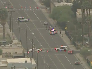 Driver hits, kills woman crossing PHX street