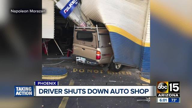 Truck smashes into Valley auto shop
