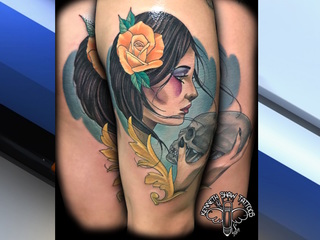 Tattoo artist offering services to cover scars