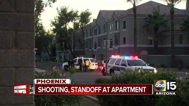A man barricaded himself in a Phoenix apartment unit after shooting a woman