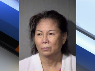 PD: Woman drives home with man on hood of car